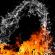 Stock Photo: Fire flames with water splash