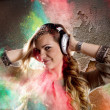 Young girl listens to music — Stock Photo