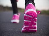 Runner feet running on road — Stock Photo