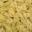Spilled raw farfalle pasta — Stock Photo