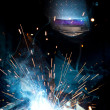 Stock Photo: Welder in action with bright sparks.