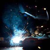 Welder in action with bright sparks. — Stock Photo
