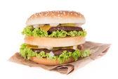 Delicious hamburger over white — Stock Photo