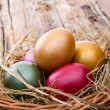 Easter colored eggs on hay — Stock Photo #42851825