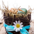 Easter colored eggs on hay — Stock Photo #42855103