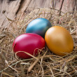 Easter colored eggs on hay — Stock Photo #42865403