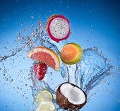 Fruit with water splash — Stock Photo