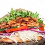 Постер, плакат: Pita bread and kebab meat