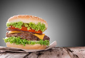 Delicious hamburger on wood — Stock Photo