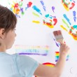 Beautiful little girl painting — Stock Photo #45120857