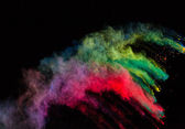 Colorful dust in freeze motion. — Stockfoto