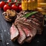 Tasty beef steak on wooden table — Stock Photo #45796083