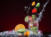 Fresh fruit cocktail with liquid splash — Stock Photo