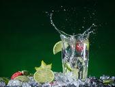 Fruit cocktail with splashing liquid — Stock Photo