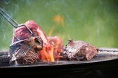 Tasty beef steak on grill — Stock Photo