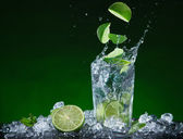 Fresh fruit cocktail in freeze motion splashing — Stock Photo