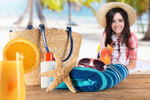 Close-up of summer accessories on sandy beach. — Stock Photo
