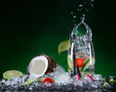 Fresh fruit cocktail in freeze motion splashing. — Stock Photo