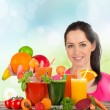 Young happy woman with Fresh juice mix fruit — Stock Photo #48457021