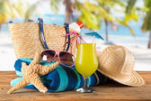 Summer accessories on sandy beach — Stock Photo