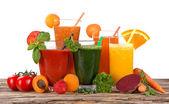 Fresh fruit juices on wooden table — Stok fotoğraf