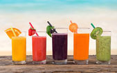 Fresh fruit juices on wooden table — Stock Photo