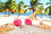 Tasty ice creams on sandy beach — Stock Photo