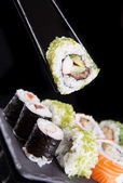 Sushi set on dark background — Stock Photo