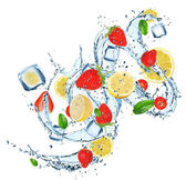 Fresh fruit with water splash — Stock Photo