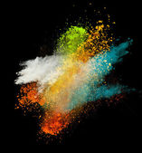 Colored powder in freeze motion — Stock Photo