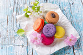 Colored macaroons on wooden table — Stock Photo