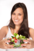 Young happy woman with fresh salad — Stock Photo