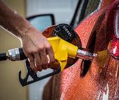 Gasoline dispenser in the car. — Stock Photo