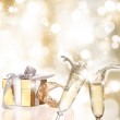 Champagne glasses on gold blur background — Stock Photo #7292516