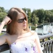 Stock Photo: Pretty Caucasigirl in city park