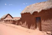 Traditional village with clay buildings in Bolivia — Stock Photo