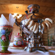 Russian tea drinking with samovar and bread rolls — Stock Photo #40252023