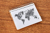 Notebook with world map — Stockfoto