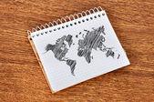 Notebook with world map — Stok fotoğraf