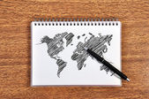 Note book with world map — Stock Photo