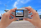 Camera and cruise liner — Stock Photo