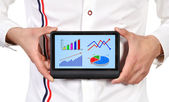 Tablet with scheme growth profits — Stock Photo