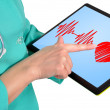 Heartbeat symbol on touchpad - Stock Photo
