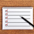 Stock Photo: Notebook with checklist