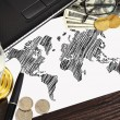 Stock Photo: World map and money