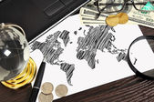 World map and money — Stockfoto