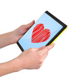 Tablet with heart — Stock Photo
