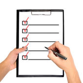 Clipboard with checklist — Stockfoto