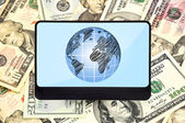 Tablet with planet — Stock Photo