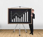 Businessman and chart on blackboard — Stock Photo